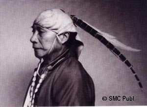 A man in headgear decorated with feathers of Syrmaticus mikado and Lophura swinhoii. Tapangu Village, Tsou